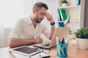 Tired ponder man thinking about way to complete task